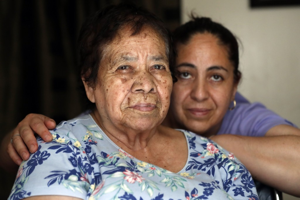 Eugenia Rodriguez, right, and her 84-year-old non-citizen mother, Francisca Perez, pose for a portrait in their house Wednesday, June 30, 2021, in Chi...