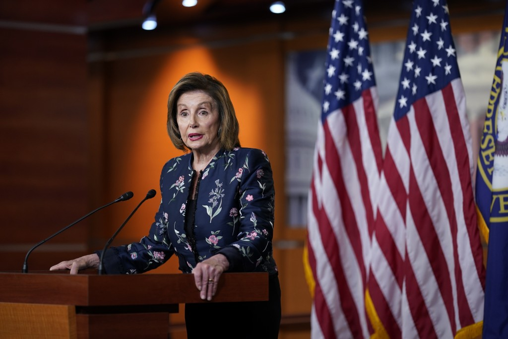 FILE - In this July 22, 2021, file photo Speaker of the House Nancy Pelosi, D-Calif., meets with reporters at the Capitol in Washington. Pelosi and Li...