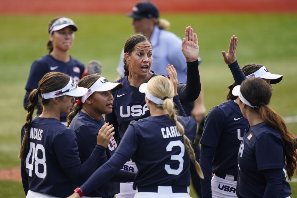 United States' Cat Osterman, center, reacts with teammates after the sixth inning of a softball game against Mexico at the 2020 Summer Olympics, Satur...