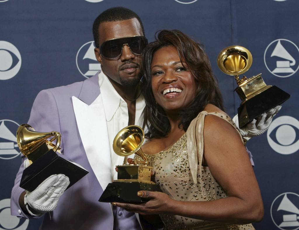 FILE - In this Feb. 8, 2006, file photo, Kanye West and his mother, Donda, hold his three awards backstage at the 48th Annual Grammy Awards in Los Ang...