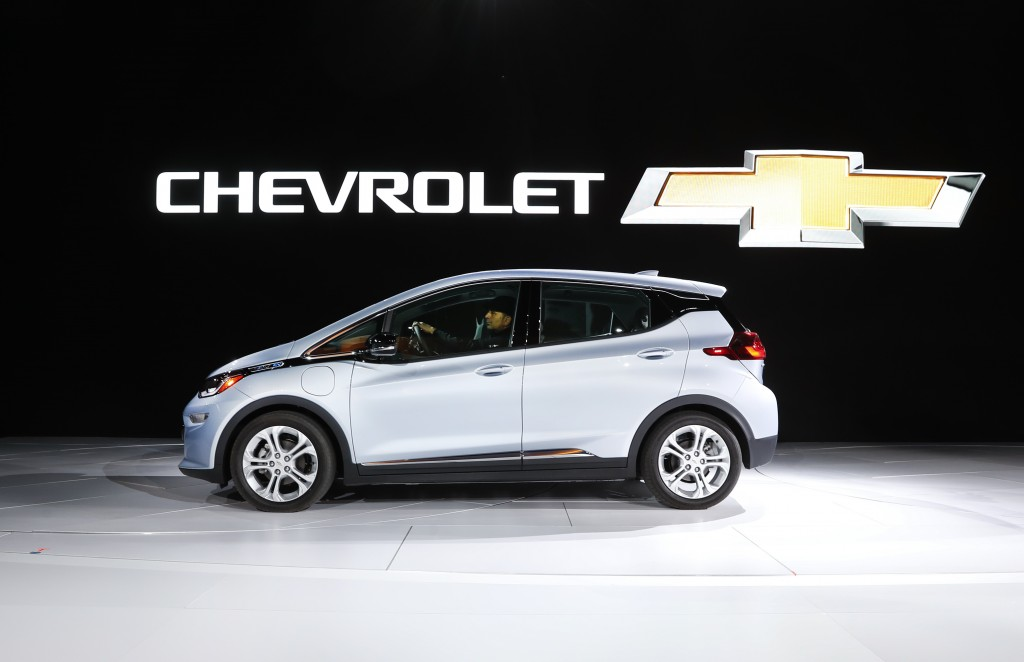 FILE - In this Jan. 9, 2017 file photo the Chevrolet Bolt is on display at the North American International Auto Show in Detroit.  General Motors is r...