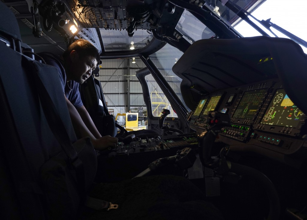 Avionics mechanic Mike Luong inspects the control panel of Sikorsky Firehawk helicopter at the California Department of Forestry and Fire Protection's...