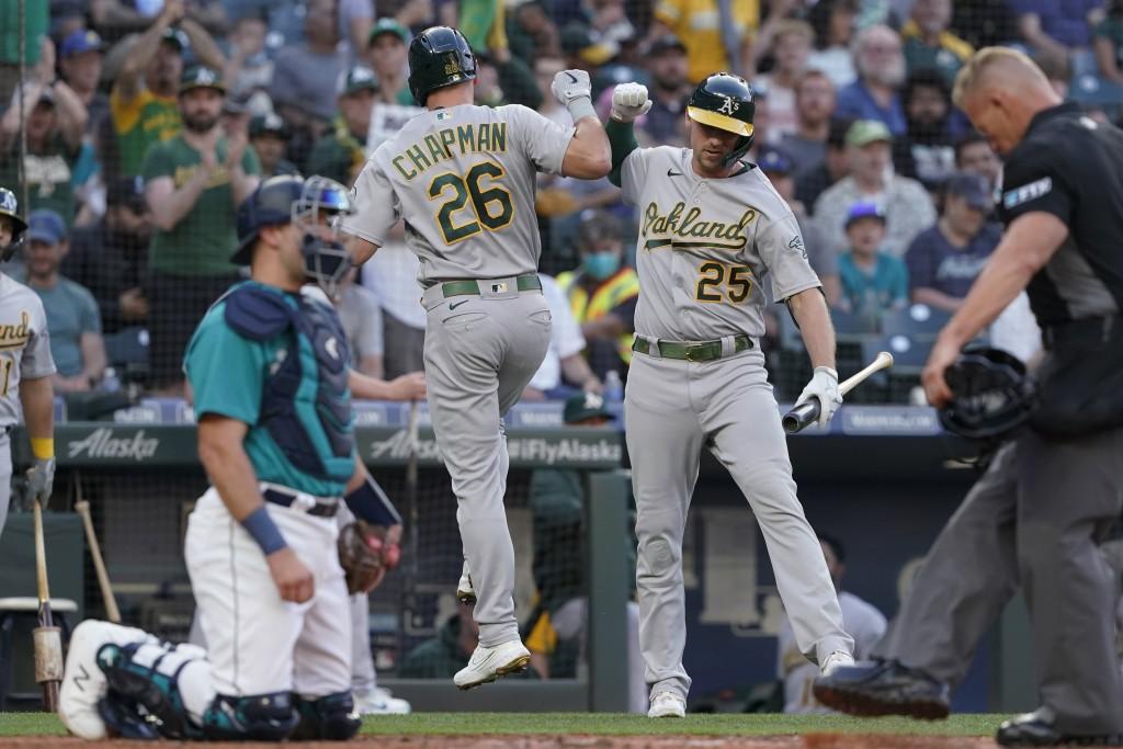 Oakland Athletics' Matt Chapman (26) greets Stephen Piscotty (25) after Chapman hit a solo home run during the third inning of the team's baseball gam...