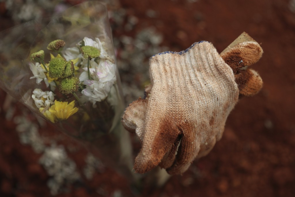 Used gloves belonging to a relative are left at the grave of a COVID-19 victim at a cemetery in Bogor, West Java, Indonesia on July 14, 2021. With the...