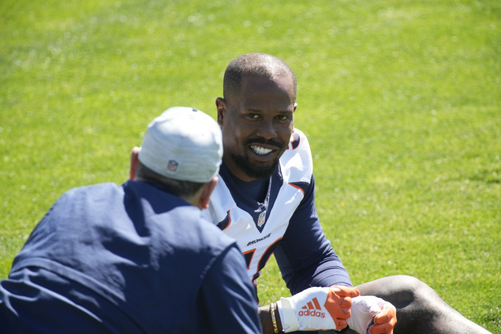 FILE - Denver Broncos outside linebacker Von Miller speaks to an unidentified person during an NFL organized training  session at the team's headquart...