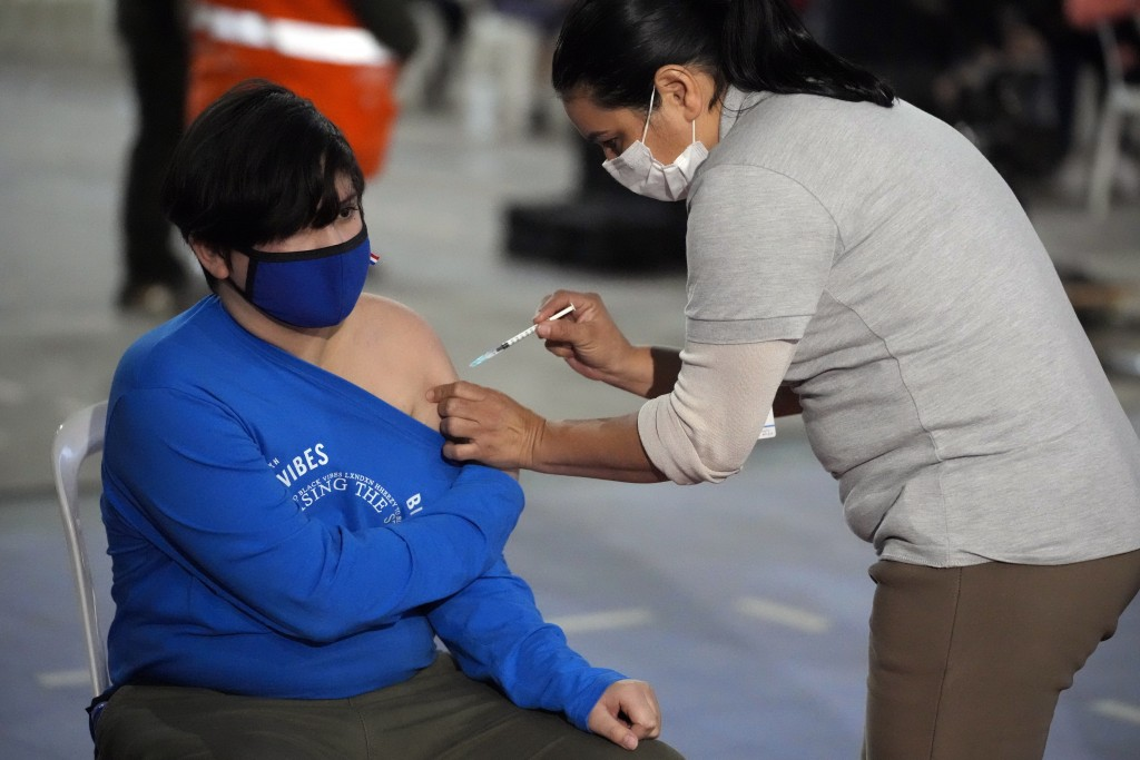 Boy gets a shot of a COVID-19 vaccine from a nurse in Asuncion, Paraguay,on July 23, 2021.