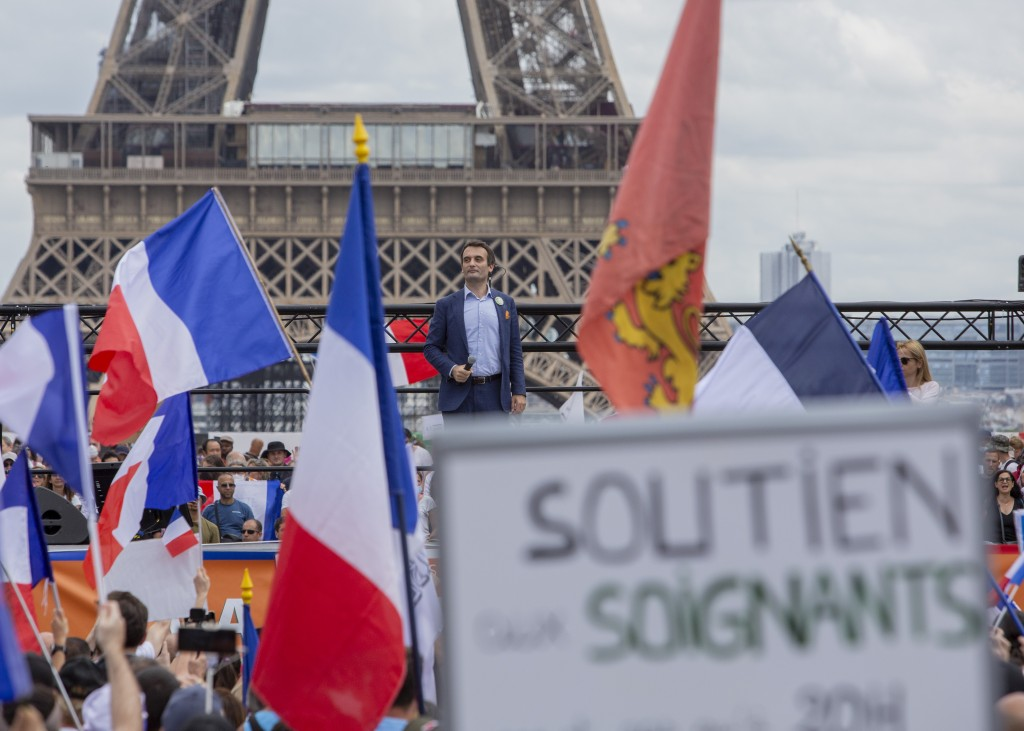 Head of right-wing party 'Les Patriotes' Floriant Philippot stands in front of thousands of protesters gathered at Place Trocadero near the Eiffel Tow...