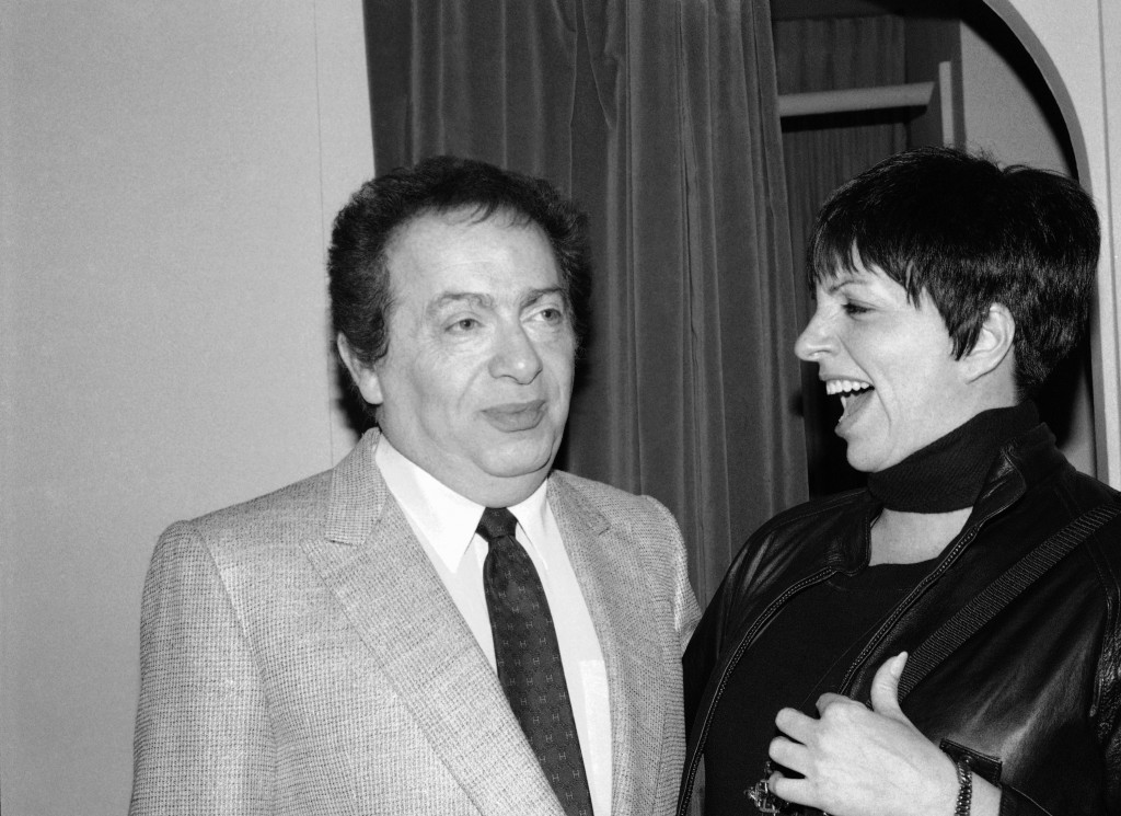 FILE - In this Feb. 4, 1991, file photo, Liza Minnelli chats with comic Jackie Mason during a visit backstage at the Neil Simon Theater in New York. M...
