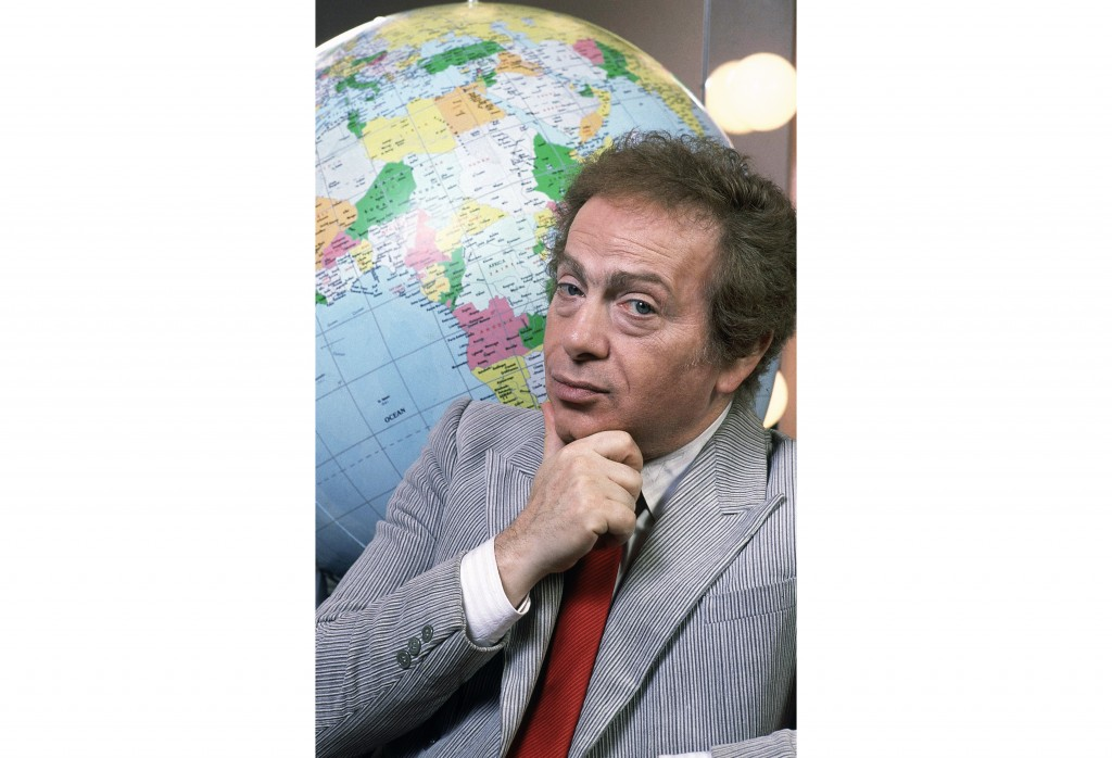 FILE - In this Jan. 27, 1987, file photo, Jackie Mason poses in his dressing with a globe as he stars in his own Broadway show in New York. Mason, a r...