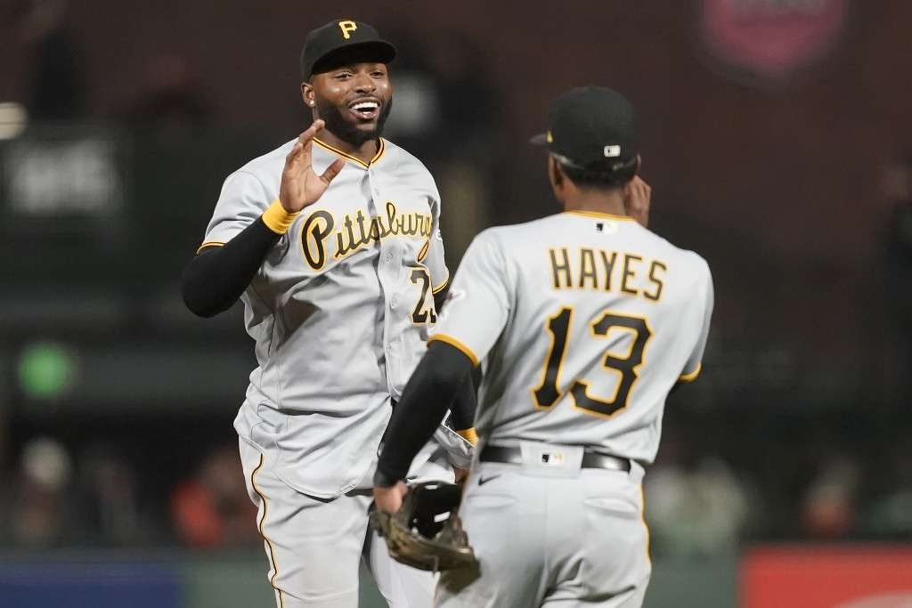 Pittsburgh Pirates' Gregory Polanco, left, celebrates with Ke'Bryan Hayes (13) after the Pirates defeated the San Francisco Giants 10-2 in a baseball ...
