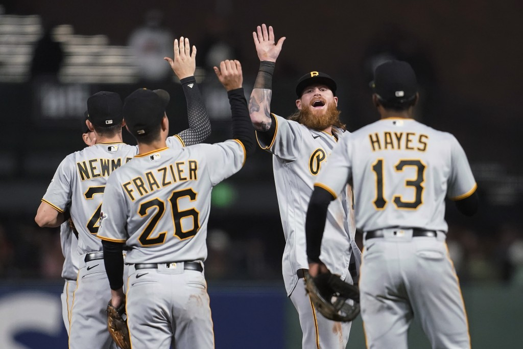Pittsburgh Pirates' Ben Gamel, second from right, celebrates with Kevin Newman, left, Adam Frazier (26) and Ke'Bryan Hayes (13) after the Pirates defe...