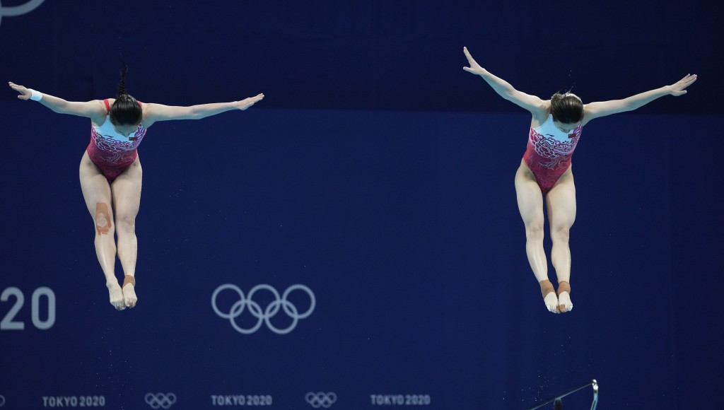 Shi Tingmao and Wang Han compete during the Women's Synchronized 3m Springboard Final at the Tokyo Aquatics Centre at the 2020 Summer Olympics, Sunday...