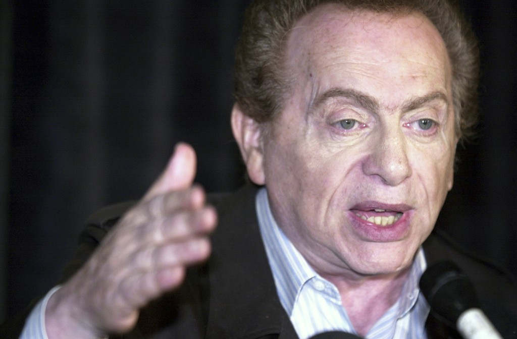 FILE - In this Wednesday, Aug 28, 2002, file photo, comic Jackie Mason addresses the media at Zanie's comedy club in Chicago about the club's decision...
