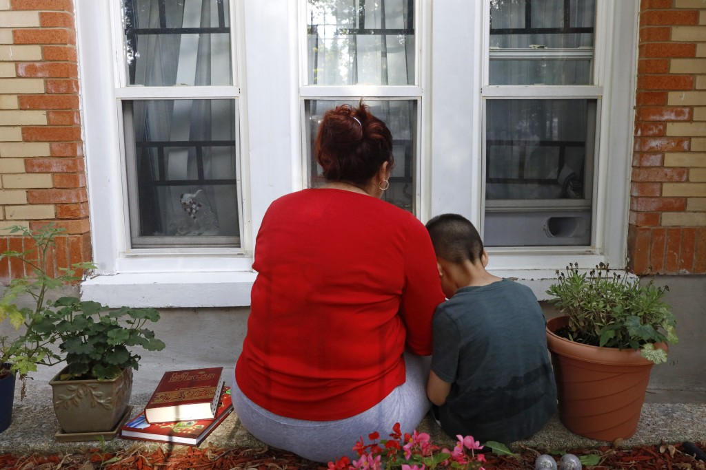 Eugenia Rodriguez shares a moment with her youngest son, Aaron, 6, while reading a children's book Friday, July 2, 2021, in Chicago's Little Village n...