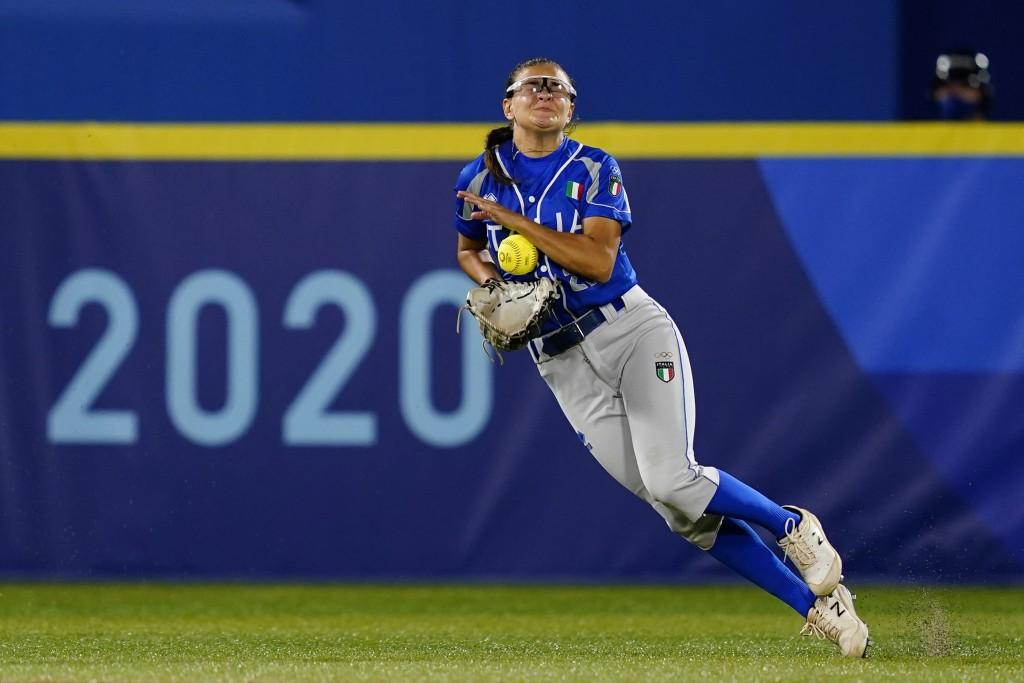 Italy's Laura Vigna catches a single by Japan's Yu Yamamoto during a softball game at Yokohama Baseball Stadium during the 2020 Summer Olympics, Satur...