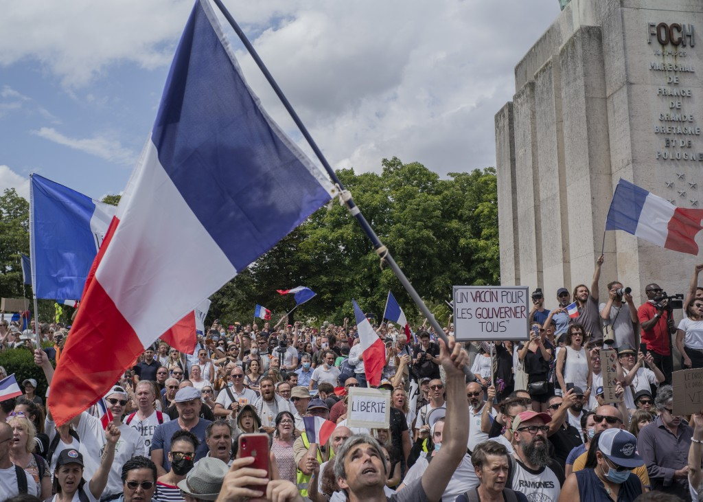 Thousands of protesters gather at Place Trocadero near the Eiffel Tower attend a demonstration in Paris, France, Saturday July 24, 2021, against the C...