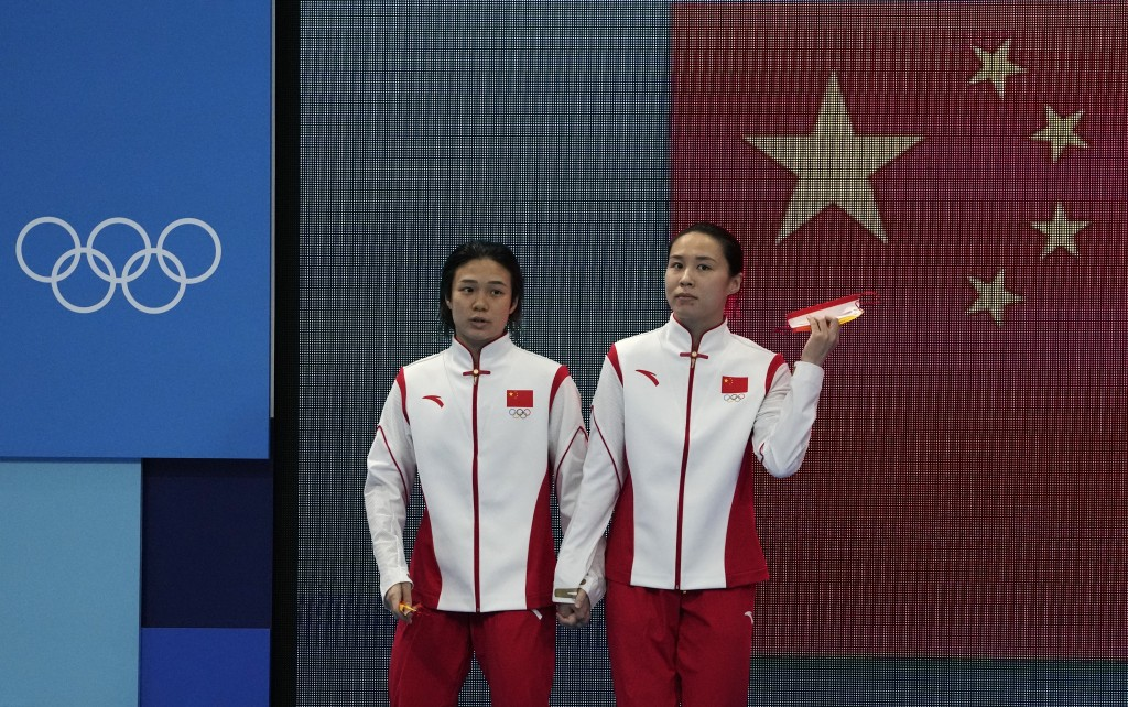 Shi Tingmao and Wang Ha of China before the Women's Synchronized 3m Springboard Final at the Tokyo Aquatics Centre at the 2020 Summer Olympics, Sunday...