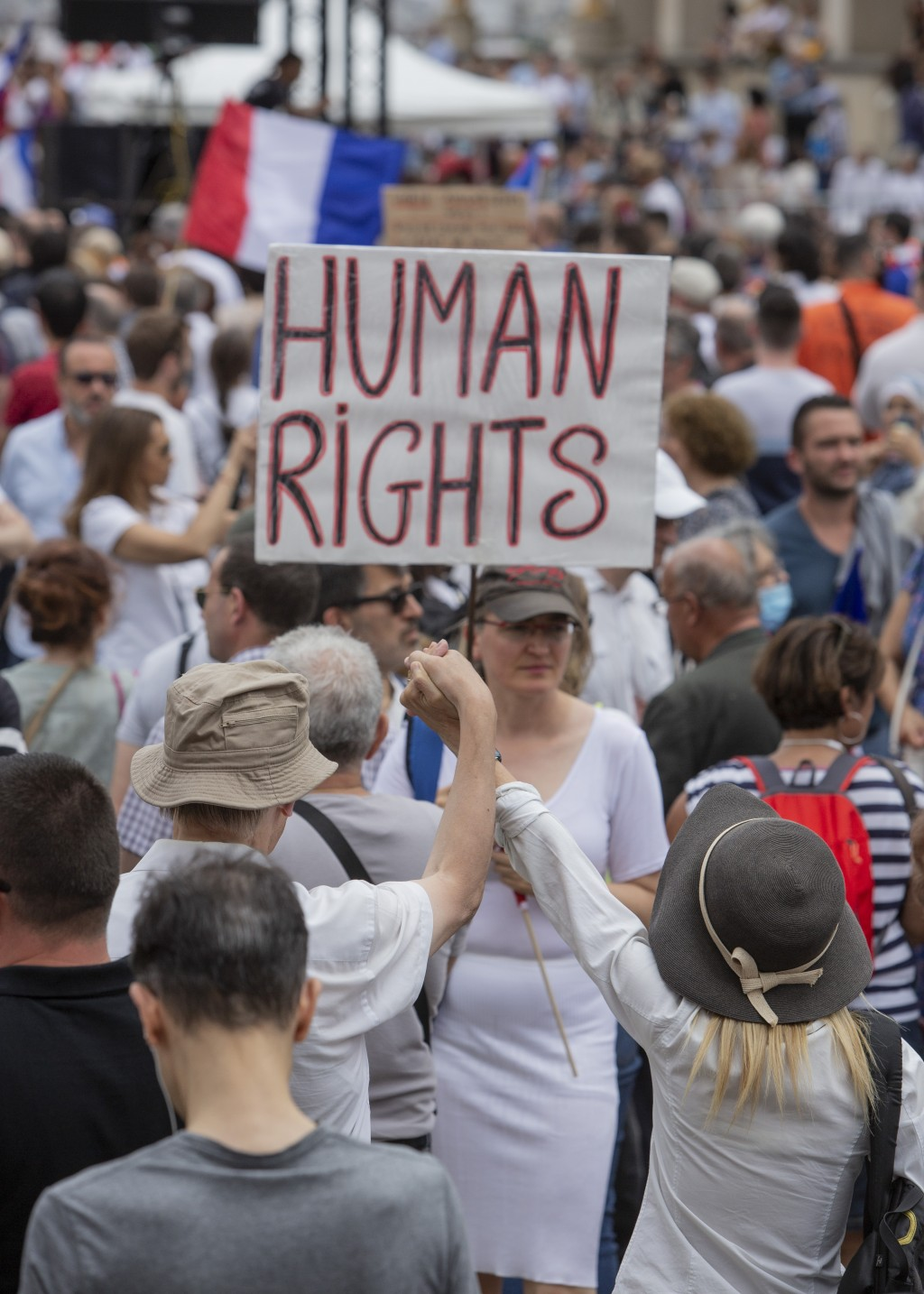 Protesters attend a demonstration in Paris, France, Saturday July 24, 2021, against the COVID-19 pass which grants vaccinated individuals greater ease...