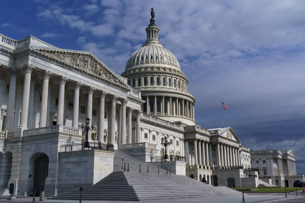 FILE - In this July 1, 2021, file photo shows the Capitol in Washington. Senators negotiating two colossal bills delivering $4 trillion for bolstering...