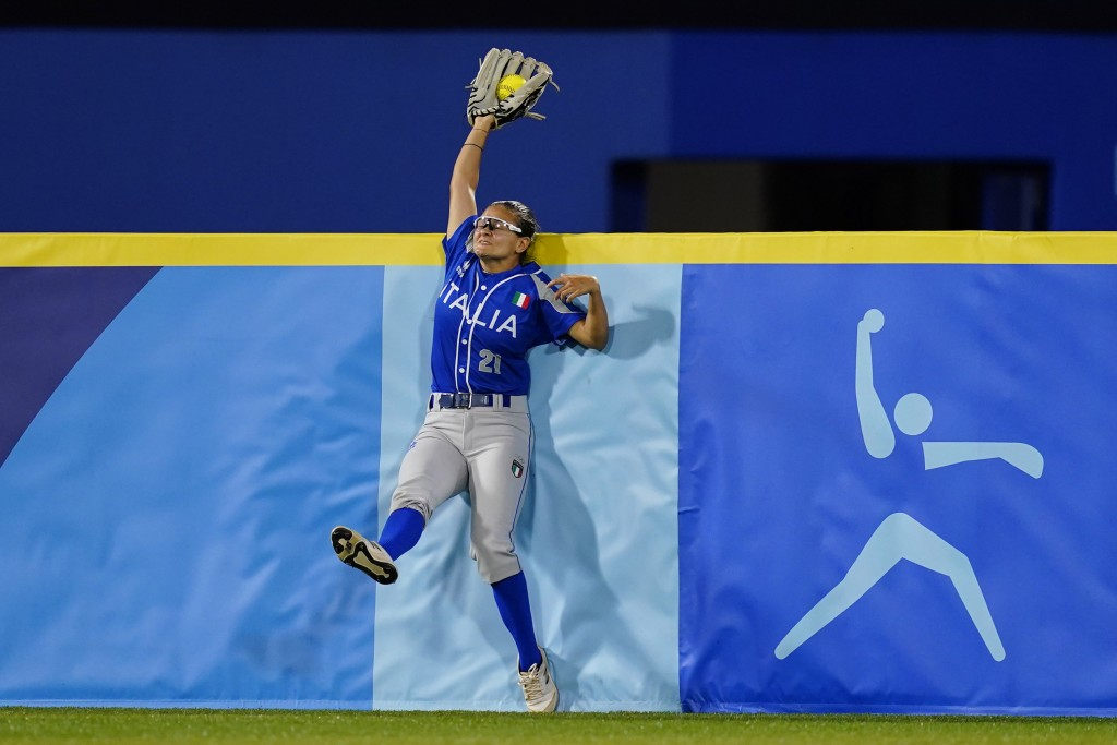 Italy's Laura Vigna catches a fly out during a softball game against Japan at Yokohama Baseball Stadium during the 2020 Summer Olympics, Saturday, Jul...