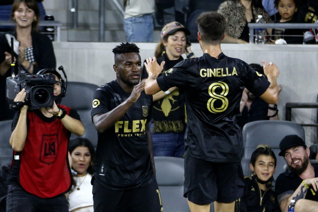 Los Angeles FC midfielder Jose Cifuentes, left, celebrates his goal with Francisco Ginella (8) during the second half of the team's MLS soccer match a...