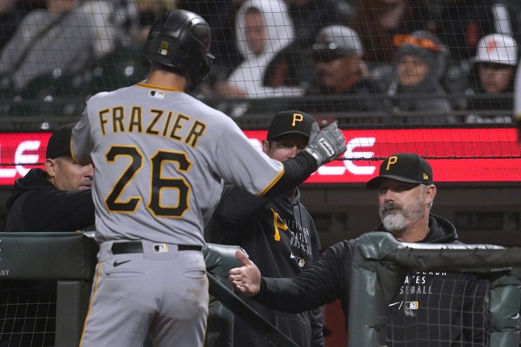 Pittsburgh Pirates' Adam Frazier (26) is congratulated by manager Derek Shelton, right, after scoring against the San Francisco Giants during the eigh...