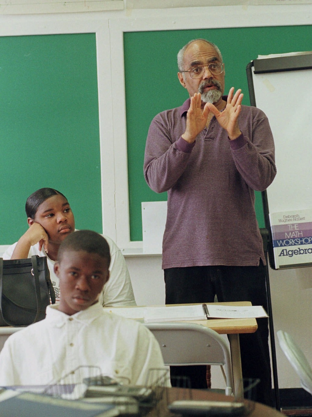 """FILE  - In this April 6, 1990 file photo, Robert """"Bob"""" Moses teaches an algebra class at Lanier High School in Jackson, Miss.  Moses, a civil rights a..."""
