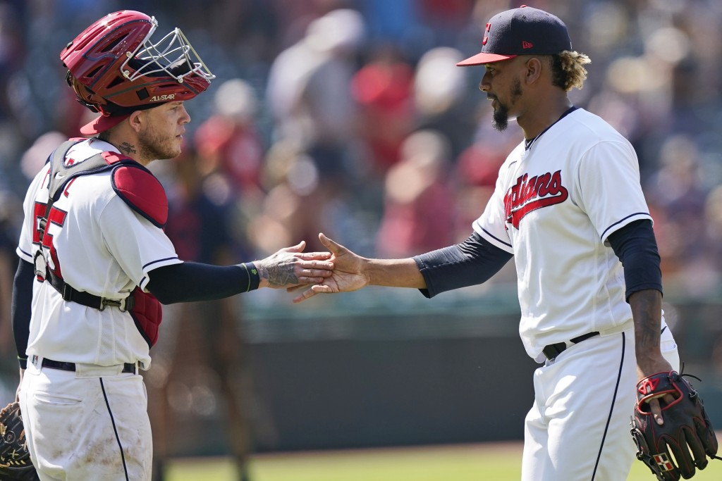 Cleveland Indians relief pitcher Emmanuel Clase, right, is congratulated by catcher Roberto Perez after they defeated the Tampa Bay Rays in a baseball...