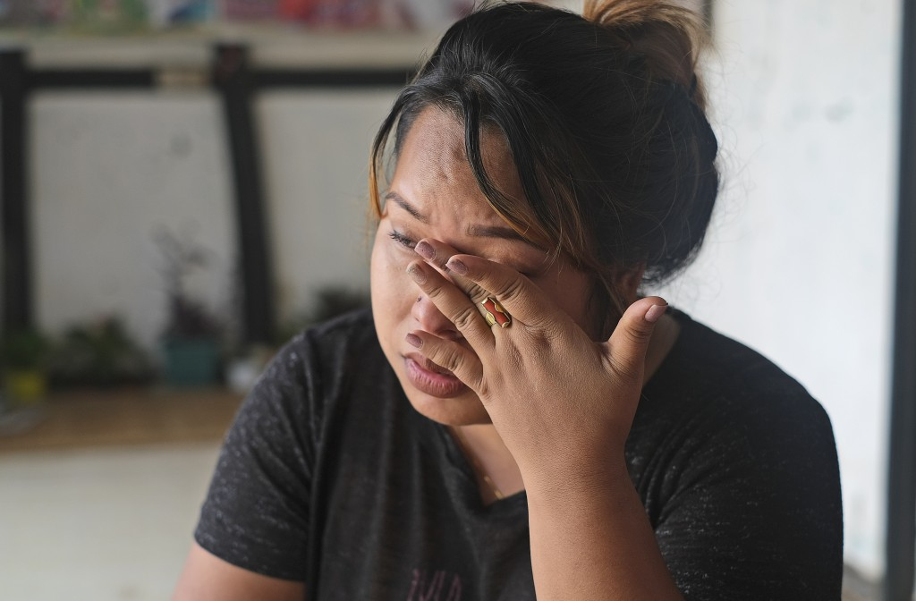 Diana Khumanthem, 30, wipes her tears as she recounts her COVID-19 experience sitting at home in Imphal, in the northeastern Indian state of Manipur, ...