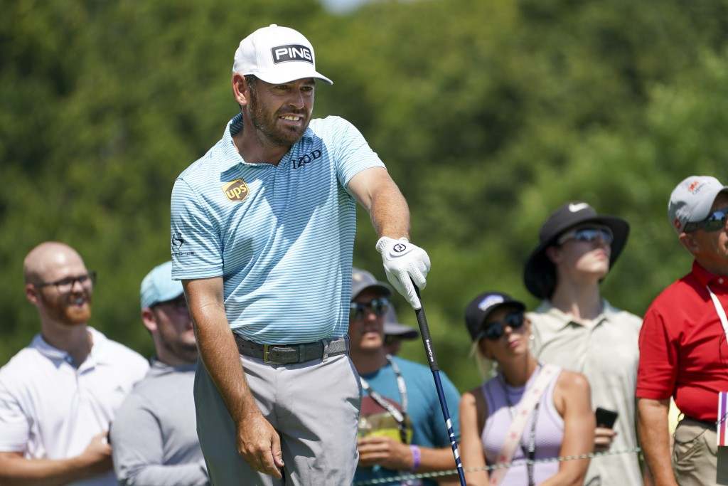 Louis Oosthuizen watches his tee shot on the 11th hole during the final round of the 3M Open golf tournament in Blaine, Minn., Sunday, July 25, 2021. ...