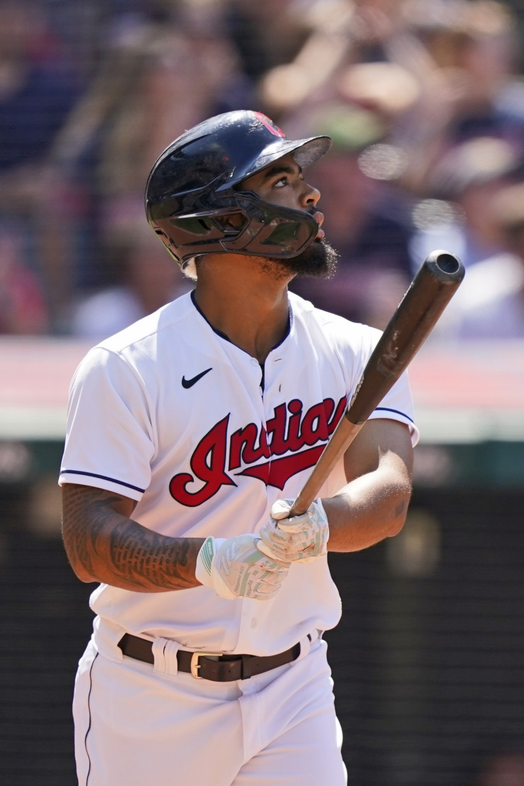 Cleveland Indians' Bobby Bradley watches his sacrifice fly in the eighth inning of a baseball game against the Tampa Bay Rays, Sunday, July 25, 2021, ...