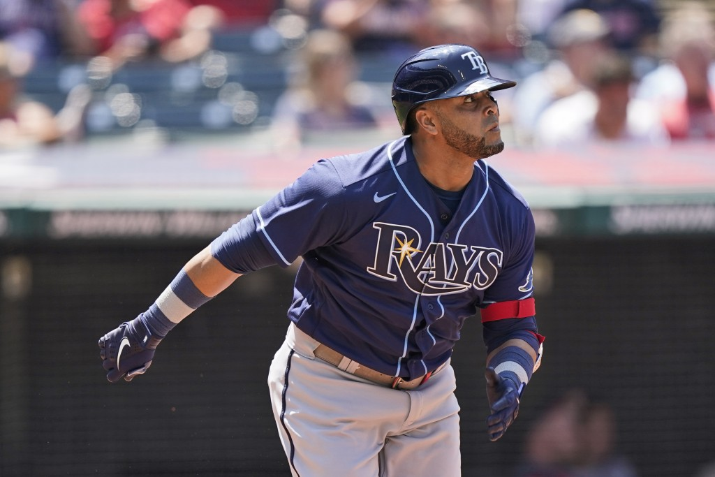 Tampa Bay Rays' Nelson Cruz watches his solo home run in the sixth inning of a baseball game against the Cleveland Indians, Sunday, July 25, 2021, in ...