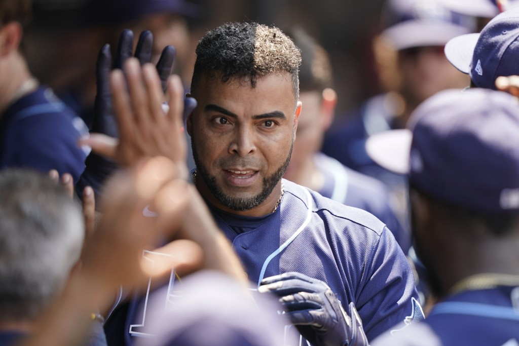 Tampa Bay Rays' Nelson Cruz is congratulated by teammates after hitting a solo home run in the sixth inning of a baseball game against the Cleveland I...