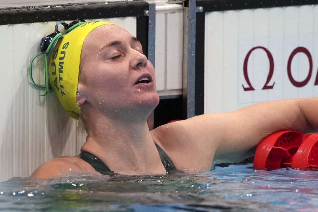 Ariarne Titmus of Australia rests after winning the final of the women's 400-meters freestyle at the 2020 Summer Olympics, Monday, July 26, 2021, in T...