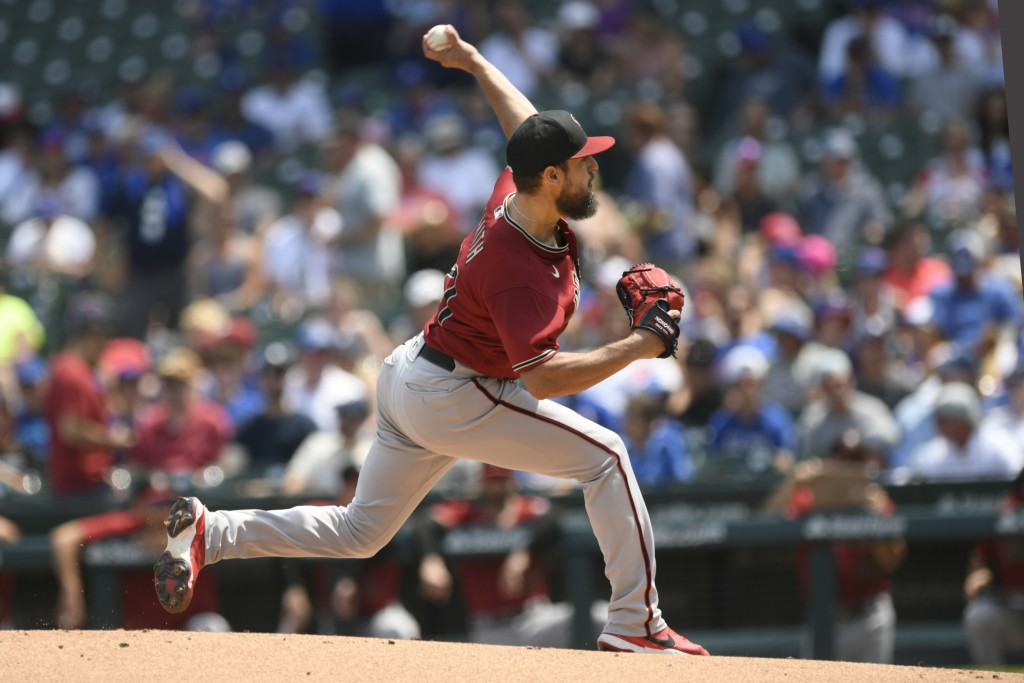 Arizona Diamondbacks starter Caleb Smith delivers a pitch during the first inning of a baseball game against the Chicago Cubs, Sunday, July 25, 2021, ...