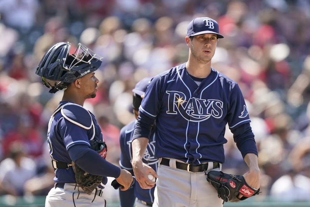 Tampa Bay Rays relief pitcher Matt Wisler talks with catcher Francisco Mejia after Wisler gave up a sacrifice fly to Bobby Bradley in the eighth innin...
