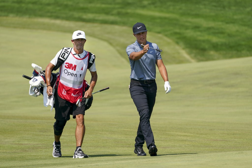 Cameron Champ, right, and caddie Chad Reynolds make their way up the 11th fairway during the final round of the 3M Open golf tournament in Blaine, Min...