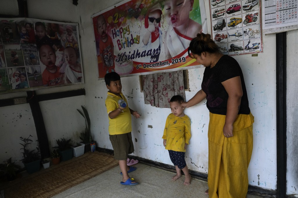 Diana Khumanthem, 30, plays with her three-year-old nephew Hridhaan, who she has decided to raise as her own after his mother Ranjita died of COVID-19...