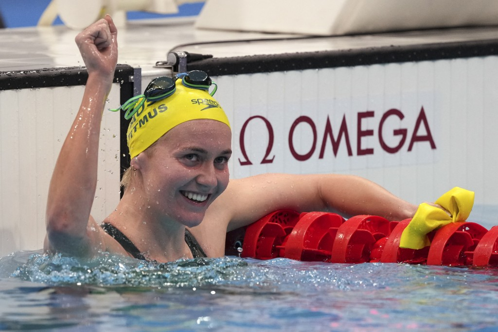 Ariarne Titmus of Australia celebrates after winning the final of the women's 400-meters freestyle at the 2020 Summer Olympics, Monday, July 26, 2021,...