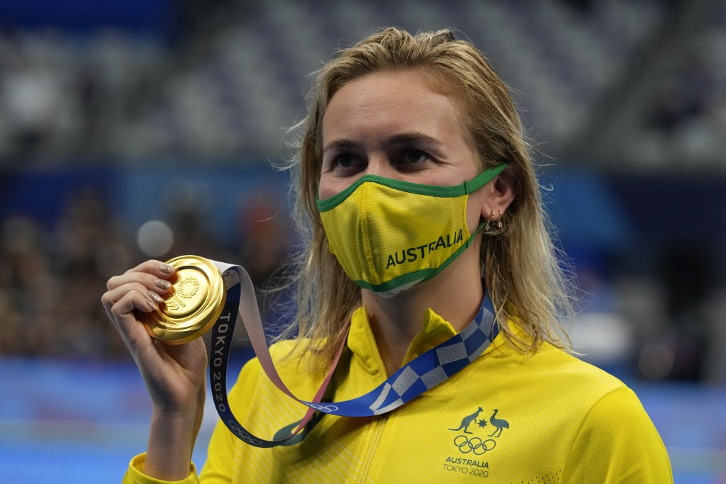 Ariarne Titmus, of Australia, poses with the gold medal after winning final the women's 400-meters freestyle at the 2020 Summer Olympics, Monday, July...