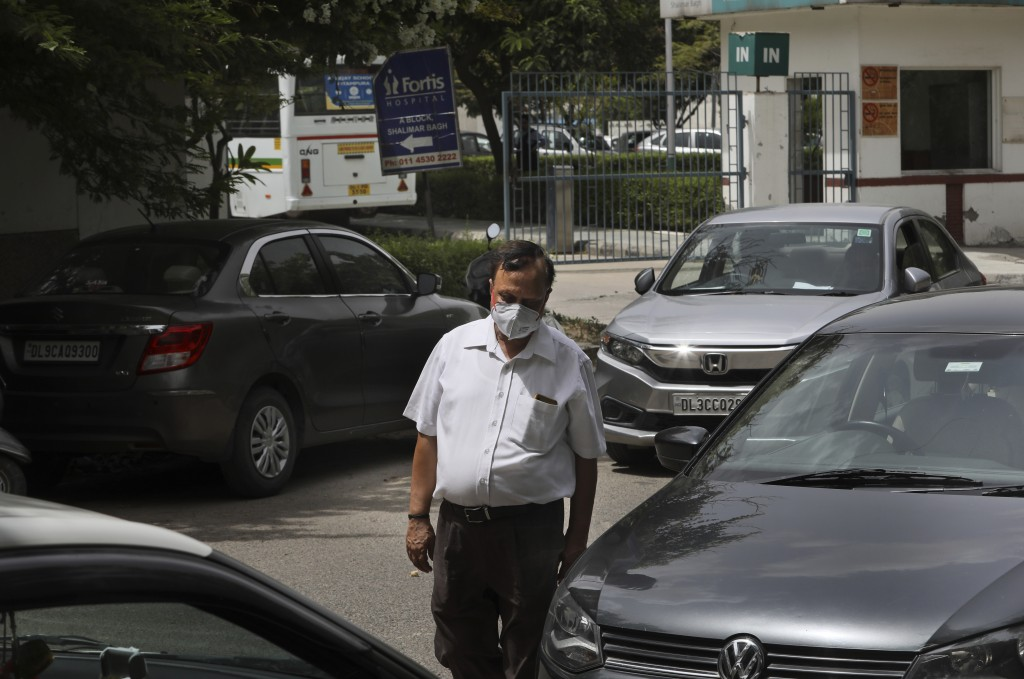 Anil Sharma leaves a hospital after visiting his son Saurav who is being treated for COVID-19 at a private hospital in New Delhi, India, Thursday, Jul...
