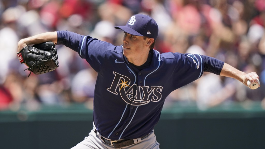 Tampa Bay Rays starting pitcher Ryan Yarbrough delivers in the first inning of a baseball game against the Cleveland Indians, Sunday, July 25, 2021, i...