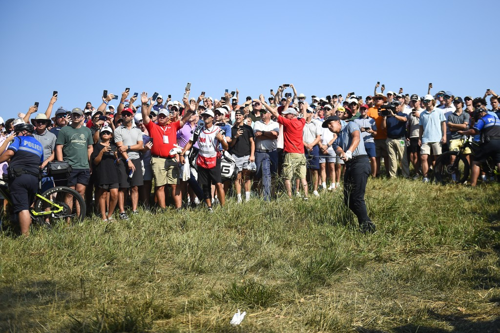 Cameron Champ hits a shot out of the rough on the 18th hole of the 3M Open golf tournament in Blaine, Minn., Sunday, July 25, 2021. (AP Photo/Craig La...