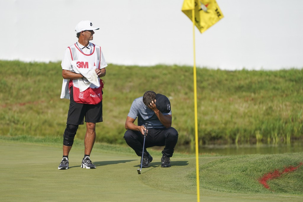 Cameron Champ, right, takes a moment with his caddie Chad Reynolds, before making his final shot and winning the 3M Open golf tournament in Blaine, Mi...