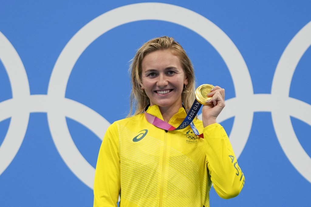 Ariarne Titmus, of Australia holds up her medal after winning the final of the women's 400-meters freestyle at the 2020 Summer Olympics, Monday, July ...