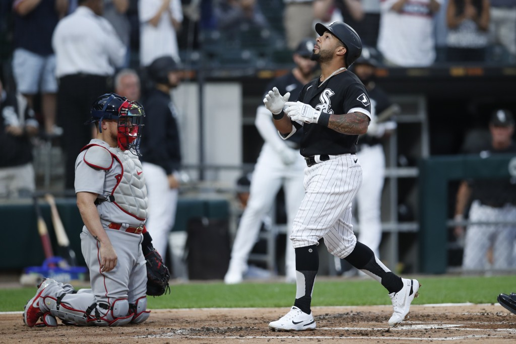 Chicago White Sox's Leury Garcia, right, celebrates in front of Boston Red Sox catcher Christian Vazquez, left, after hitting a two-run home run durin...