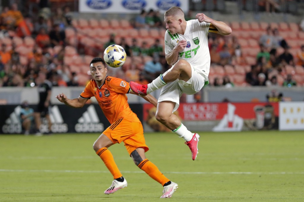 Austin FC midfielder Alexander Ring, right, brings down the ball in front of Houston Dynamo midfielder Darwin Ceren, left, during the second half of a...