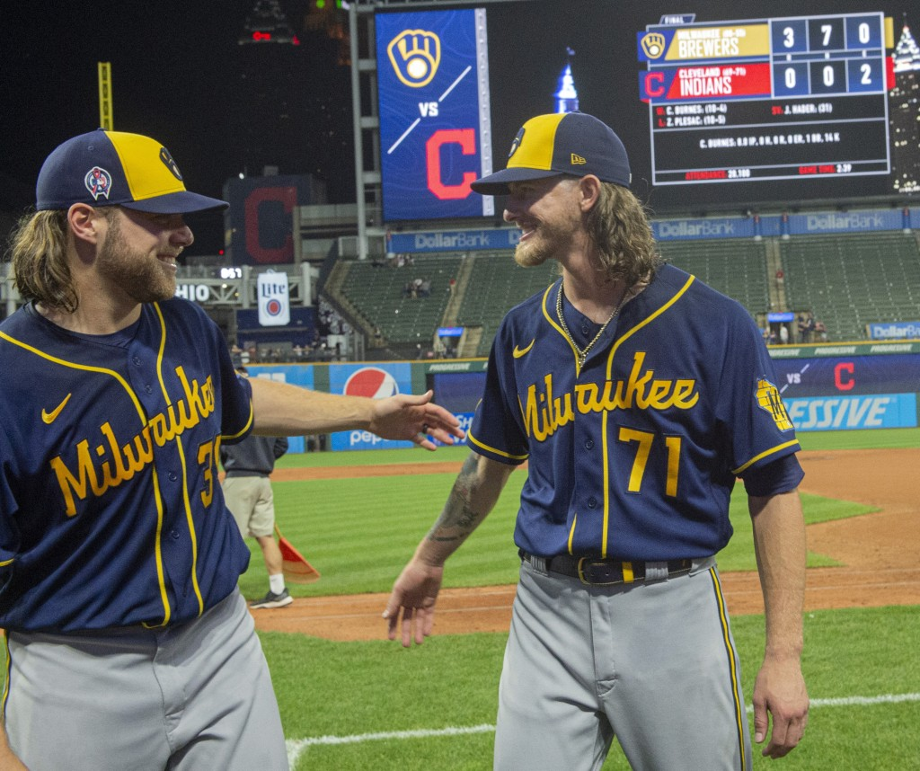 Milwaukee Brewers starter Corbin Burnes, left, and reliever Josh Hader celebrate after pitching a combined no-hitter against the Cleveland Indians in ...