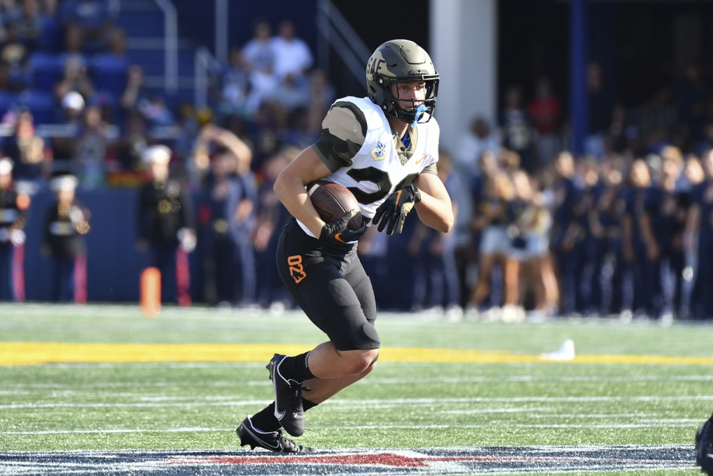 Air Force wide receiver Dane Kinamon runs the ball during the first half of an NCAA college football game against Navy, Saturday, Sept. 11, 2021, in A...