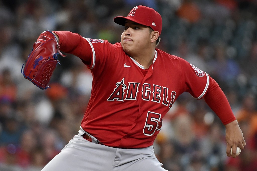Los Angeles Angels starting pitcher Jose Suarez delivers during the first inning of a baseball game against the Houston Astros, Saturday, Sept. 11, 20...
